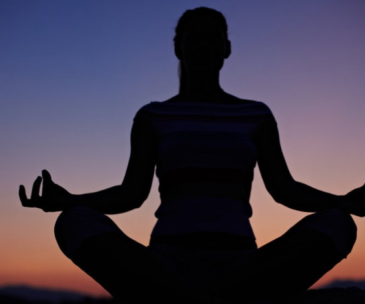 A woman meditating to reduce stress
